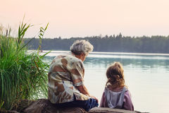 Grandmother with grandchild - senior woman and child looking at Royalty Free Stock Photography