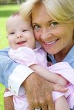 Grandmother and grandchild smiling Royalty Free Stock Photos