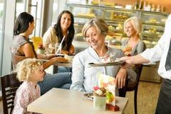 Grandmother and grandchild waiting cake order cafe. Dessert waiter plate Stock Photo