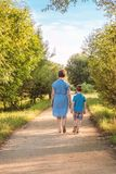 Grandmother and grandchild walking on a nature Royalty Free Stock Image