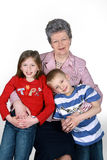 Grandmother with grandchildren. On white background stock photography