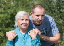 Grandmother and grandchildren Stock Image