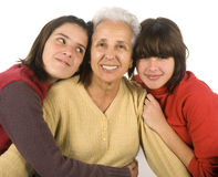 Grandmother and grandchildren. Two adolescent girls with their grandmother Royalty Free Stock Image