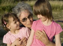 Grandmother and grandchildren Stock Images