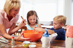 Grandmother And Grandchildren Baking Together At Home Stock Photo