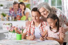 Grandmother and grandchildren drawing together Royalty Free Stock Photos