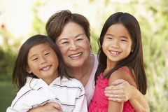 Grandmother With Grandchildren In Garden Stock Photos