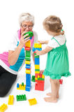 Grandmother with grandchildren playing with blocks. Fun in the studio grandmother with grandchildren royalty free stock photography