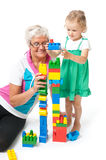 Grandmother with grandchildren playing with blocks. Fun in the studio grandmother with grandchildren royalty free stock image