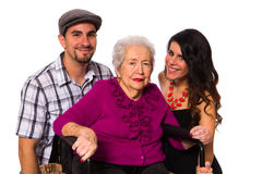 Grandmother and grandchildren. Grandchildren with their elderly handicapped grandmother on a white background royalty free stock photo
