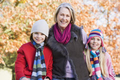 Grandmother and grandchildren on walk. Grandmother and grandchildren on autumn walk Stock Images