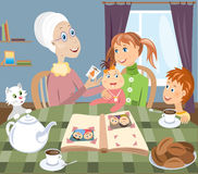 Grandmother and grandchilds. Vector illustration: grandmother with grandchilds sitting at a table Stock Image