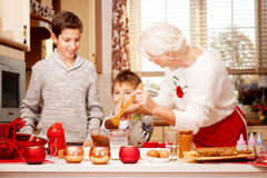Grandmother with grandchilds in kitchen, christmas. Stock Image