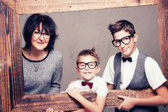 Grandmother with grandchilds posing. Royalty Free Stock Photo