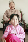 Grandmother and granddaughter. Chinese grandmother with her granddaughter at home Stock Photography