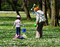 Grandmother and granddaughter. Are playing in park royalty free stock photo