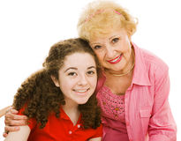 Grandmother & Granddaughter. Portrait of a grandmother and her teen granddaughter over white background Stock Photo