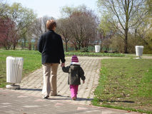 Grandmother with granddaughter. Walking on sunny day Stock Photography