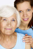 Grandmother and granddaughter Stock Images