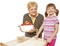 grandmother and granddaughter baking apple pie  Royalty Free Stock Photography