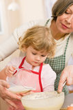 Grandmother and granddaughter baking cookies Royalty Free Stock Images