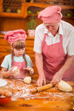 Grandmother and granddaughter baking cookies prepare dough Royalty Free Stock Images