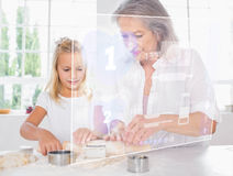 Grandmother and granddaughter baking with white interface Stock Image
