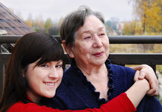Grandmother  and granddaughter  on a balcony Royalty Free Stock Photo
