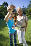 Grandmother and granddaughter at barbecue, Royalty Free Stock Image