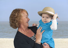 Grandmother with granddaughter,at the beach. Grandmother with granddaughter , outdoors a the beach Stock Photo