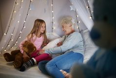 Grandmother with granddaughter. Grandmother and granddaughter in bedroom Royalty Free Stock Photo