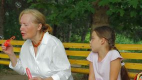 Grandmother And Granddaughter On A Bench stock footage