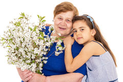Grandmother and granddaughter with a bouquet Stock Photo
