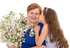 Grandmother and granddaughter with a bouquet Royalty Free Stock Photography
