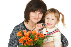 Grandmother and granddaughter with bunch of flower Stock Photos