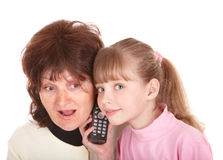 Grandmother and granddaughter call by phone. Stock Images