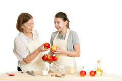 The grandmother and the granddaughter choose apples Royalty Free Stock Photography