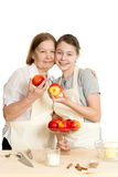 The grandmother and the granddaughter choose apples Royalty Free Stock Image