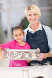Grandmother granddaughter cookies Stock Photography