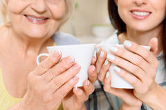 Grandmother and granddaughter with cups Royalty Free Stock Photography