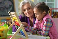 Grandmother and granddaughter do homework Stock Photography
