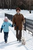 Grandmother with granddaughter and dog on walk Royalty Free Stock Photography