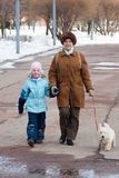 Grandmother with granddaughter and dog on walk Royalty Free Stock Photos