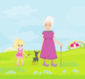 Grandmother with granddaughter and dog on a walk in the park Royalty Free Stock Images