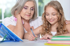 Grandmother and granddaughter doing homework Royalty Free Stock Images