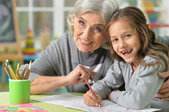 Grandmother and granddaughter drawing Royalty Free Stock Image