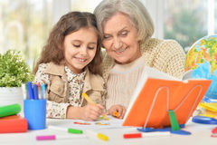 Grandmother with granddaughter drawing together Stock Photography