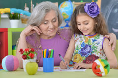 Grandmother with granddaughter drawing together Stock Photo