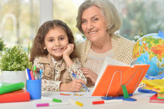 Grandmother with granddaughter drawing together Royalty Free Stock Image