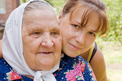 Grandmother and granddaughter embraced and happy Stock Images